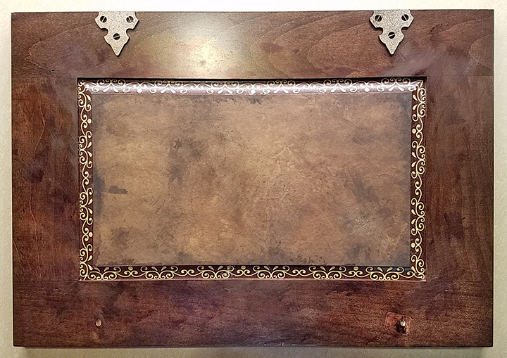 """Leather-look paper, washi tape and """"metal"""" hinges start things off."""